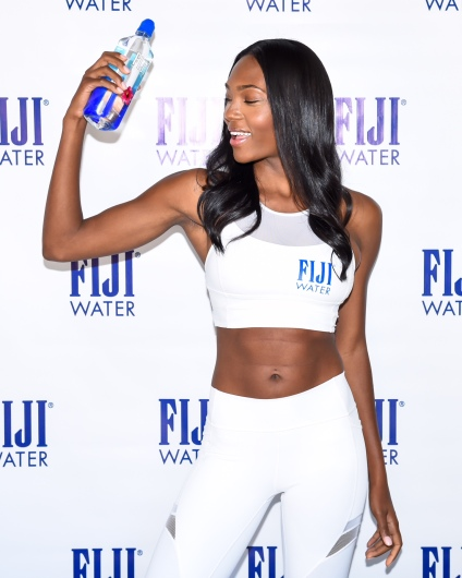 FIJI Water and model Afiya Bennett celebrate : the new Sports Cap bottle at SoulCycle